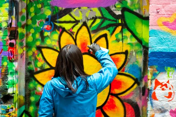 Spray painting graffiti of my tattoo (sun and flowers) in Melbourne, Australia