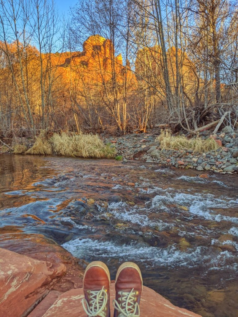 Meditating at Red Rock Crossing vortexes next to Oak Creek with a view of Cathedral Rock